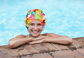 Mid-Adult Woman Wearing Colorful Swimcap in Swimming Pool