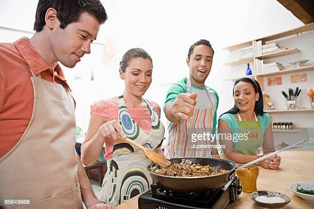 Mid-adults cooking with skillet