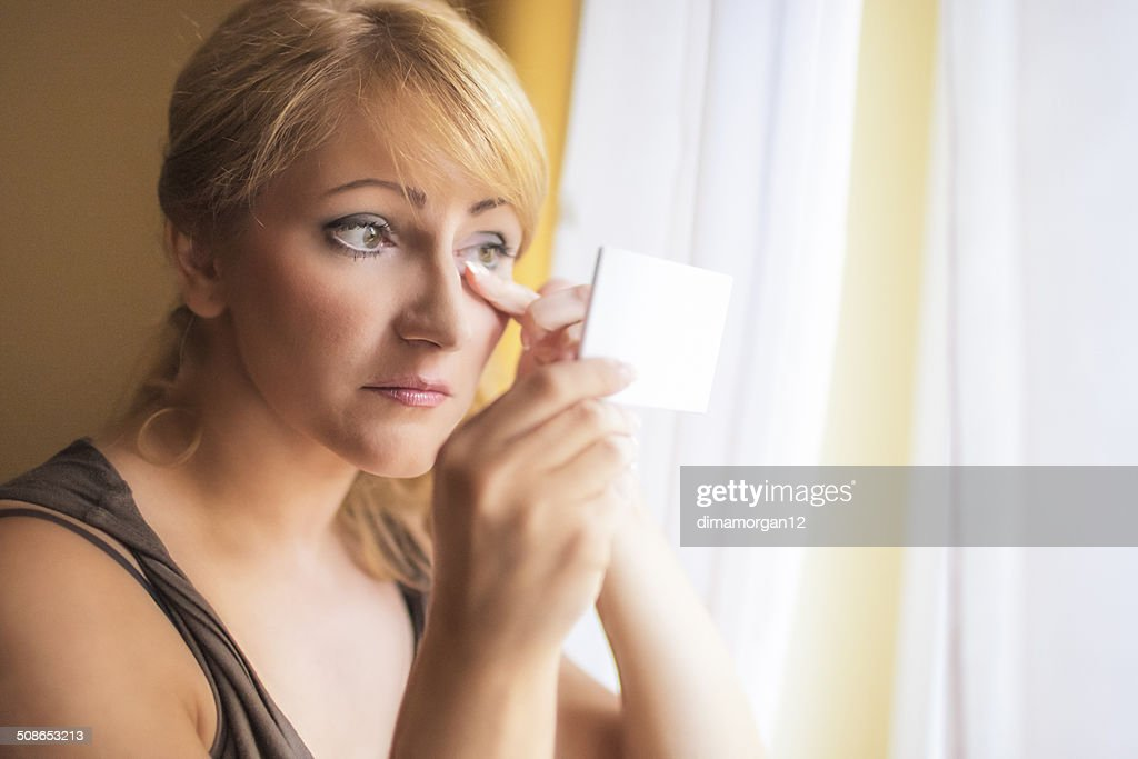 Mid-Aged Woman Self Applying Facial Makeup : Stock Photo