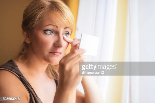 Mid-Aged Woman Self Applying Facial Makeup : Stock Photo