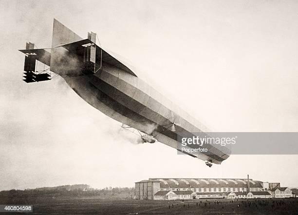 A midair battle between a German zeppelin and an Allied aircraft during World War One circa 1916