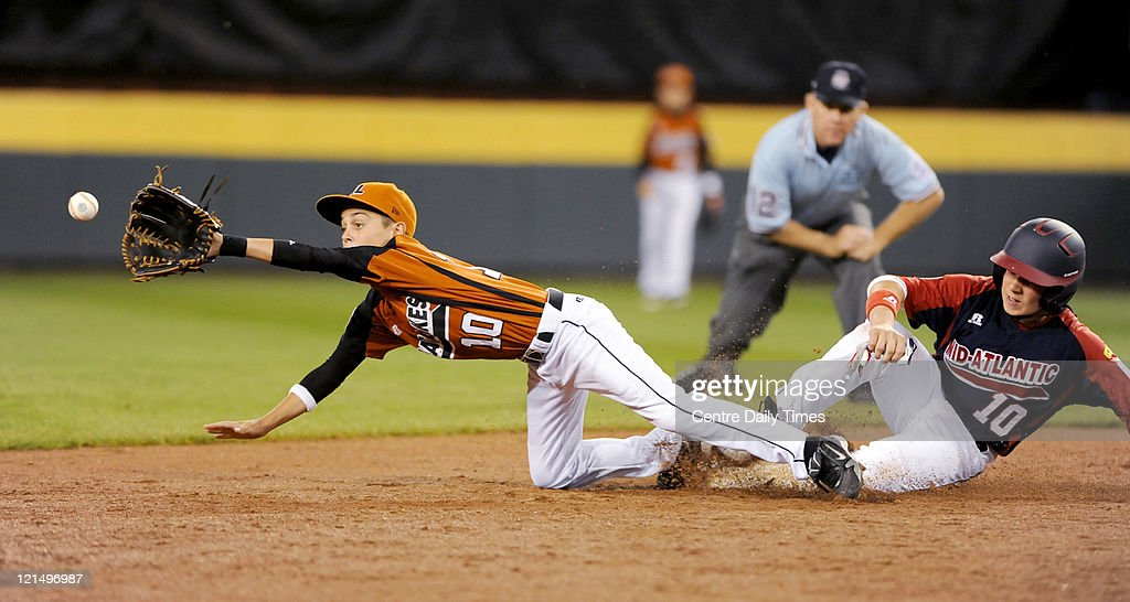 Mid-Atlantic's Brandon Miller, right, safely slides into second base as Great Lakes' Grant Larimore reaches for the catch at Lamade Stadium in South Williamsport, Pennsylvania, in the 2011 Little League World Series on Friday, August 19, 2011.