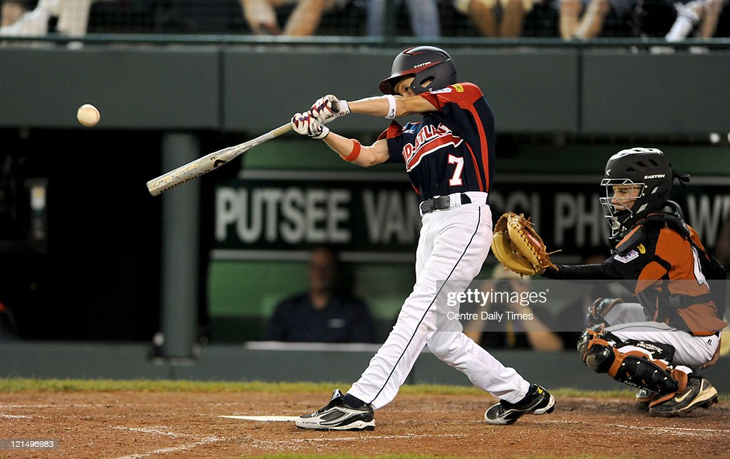 Mid-Atlantic's Tyler McCloskey hits a double in the sixth inning against Great Lakes at Lamade Stadium in South Williamsport, Pennsylvania, in the 2011 Little League World Series on Friday, August 19, 2011.