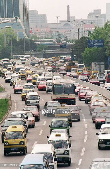 A midday traffic crawl on one of Beijing's main innercity roads 08 May as the number of cars in the Chinese capital grows by 15 percent a year...
