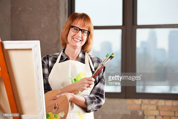 Middle Age Adult Woman Hobby Painter with Canvas Easel Hz