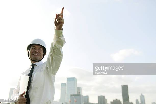 Middle age businessman wearing a helmet