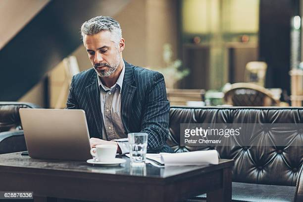 Middle age businessman working in comfortable environment