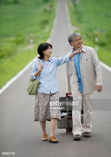 Middle age Couple walking the straight road
