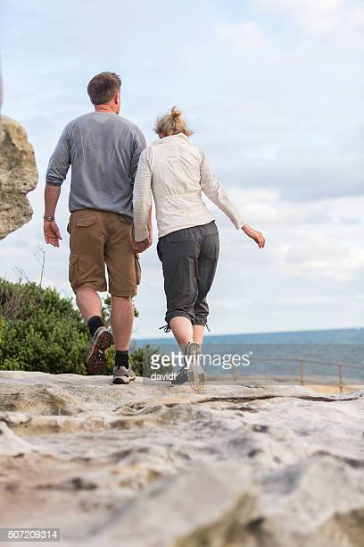 Middle Aged Active Fit Healthy Beach Couple Walking Outdoors