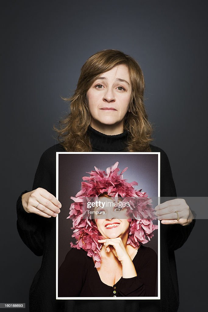 Middle aged actress showing her portrait _ vertical. : Stock Photo