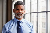 Middle aged black businessman looking to camera