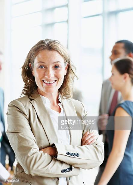 Middle aged business female with hands folded