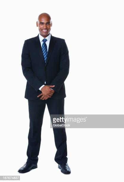 Middle aged business man standing against white background