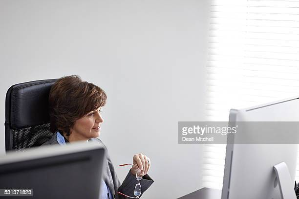 Middle aged businesswoman working on computer