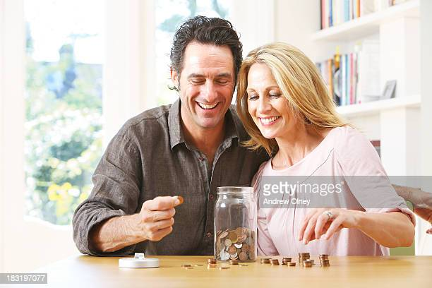 Middle aged couple counting coins