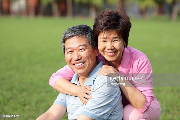 Middle aged couple smiling outdoors