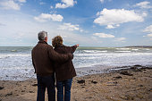 A middle aged couple standing on a beach in Balbriggan, Dublin, Ireland