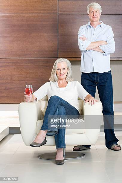 Middle aged couple with glass of wine