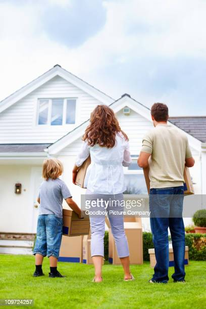 Middle aged couple with their son moving to new house