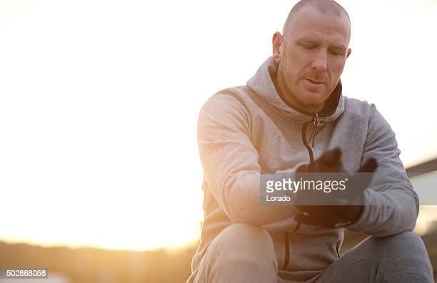 Middle aged jogger preparing to run on winter morning