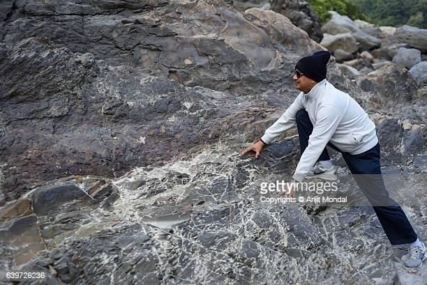 Middle Aged Man Climbing Rocky Hills in Himalayan Mountain, Rishikesh
