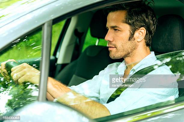 Middle aged man driving a car