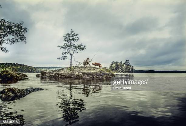 Middle aged man fishing in Sweden