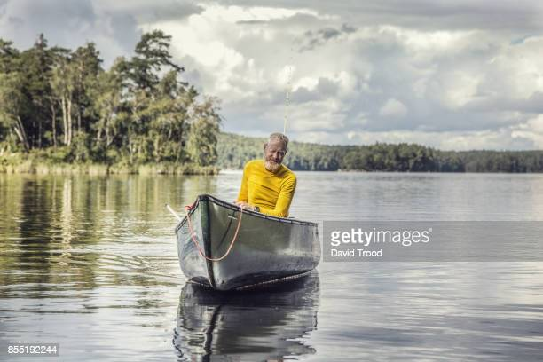 Middle aged man in a canoe.