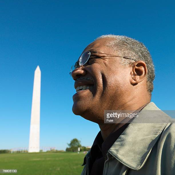 Middle Aged Man in Front of Washington Monument