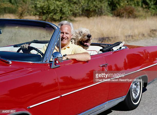 Middle Aged Man in Red Convertible with Dog
