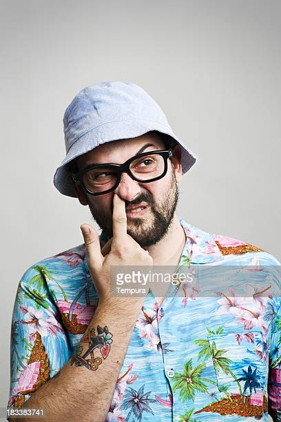 Middle aged man looking funny with summer cap and glasses