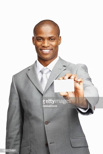 Middle aged man showing a business card against white background