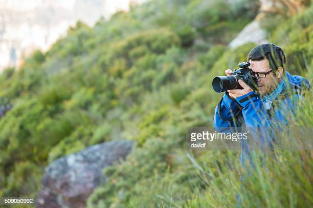 Middle Aged Photographer Bushwalking in Spectacular Blue Mountains Australian Landscape