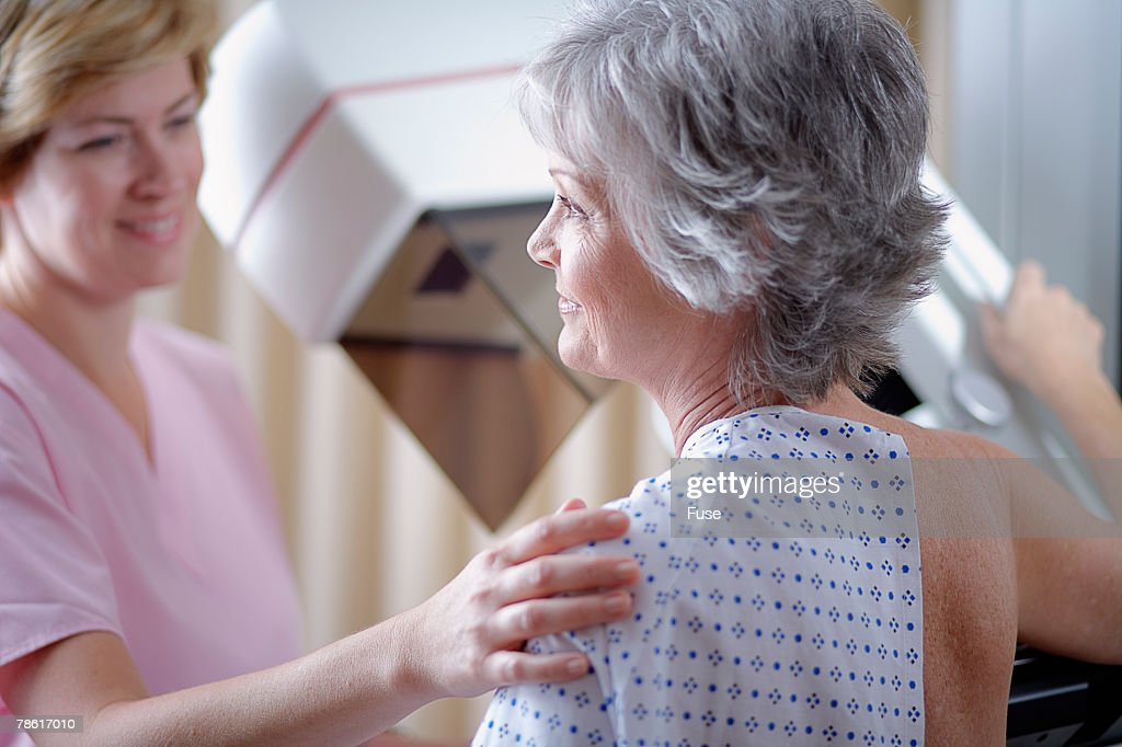 Middle Aged Woman Getting Mammogram