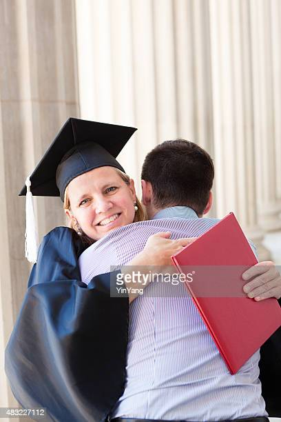 Middle Aged Woman Graduation in Higher Degree Hugging Family