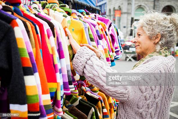 Middle aged woman happily browsing in a market