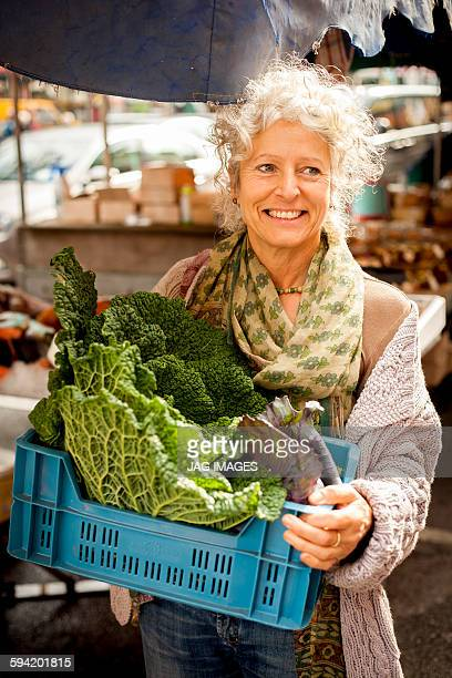 Middle aged woman in a vegetable market