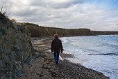 A middle aged woman standing on a beach in Balbriggan, Dublin, Ireland