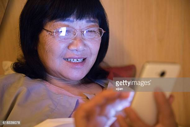 Middle aged woman using phone