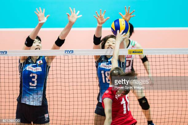 Middle blocker Nana Iwasaka and Wing spiker Mami Uchiseto of Japan block during the FIVB Volleyball World Grand Prix Hong Kong 2017 match between...