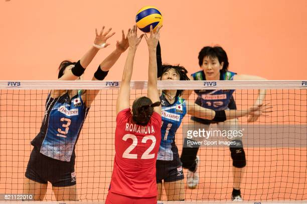 Middle blocker Nana Iwasaka of Japan and Wing spiker Yurie Nabeya of Japan blocks during the FIVB Volleyball World Grand Prix match between Japan vs...