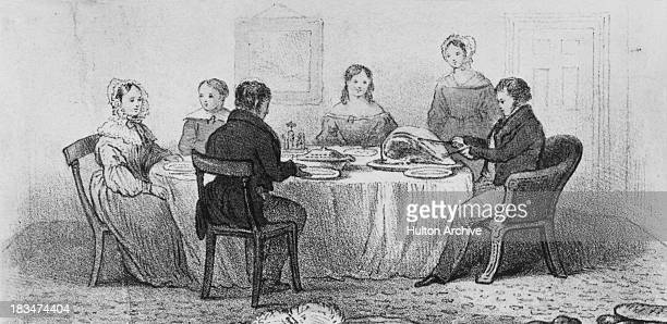 A middle class Victorian family at the dinner table circa 1850