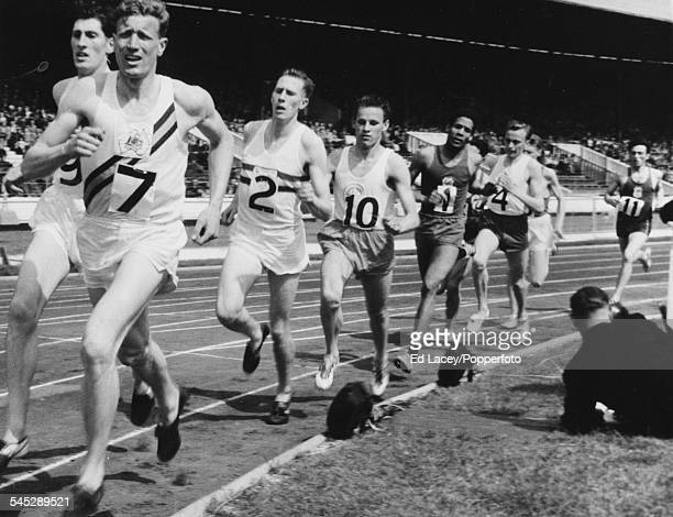 Middle distance runners Don McMillan Don Seaman and Roger Bannister lead the field during a 1 mile international race at the Inter Counties British...