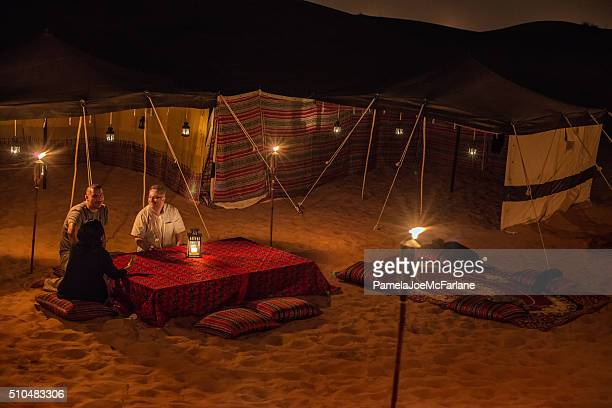 Middle Eastern and Multi-Ethnic Friends Enjoying Conversation at Desert Camp