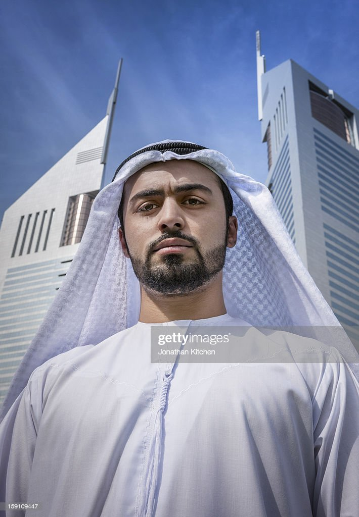 Middle eastern business man stands with importance : Stock Photo
