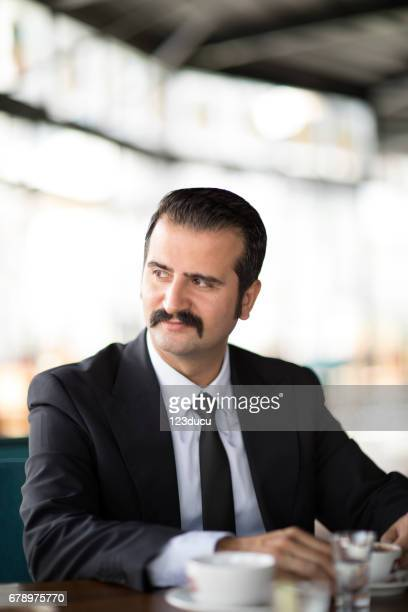 Middle Eastern Businessman At Cafe