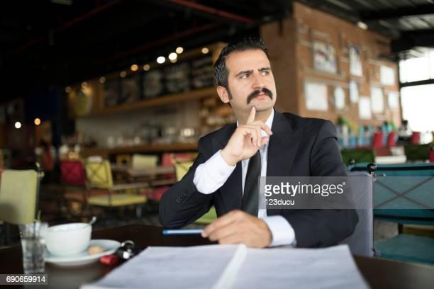Middle Eastern Businessman At Cafe