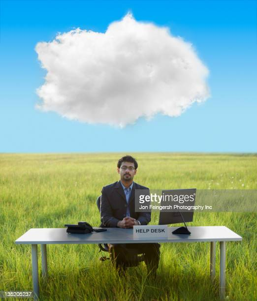 Middle Eastern businessman at help desk in field