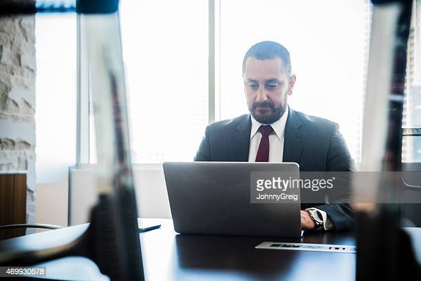 Middle Eastern businessman at work on laptop