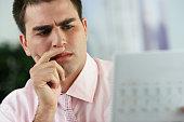 Middle Eastern businessman looking at paperwork
